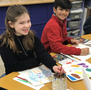 Elementary students doing art